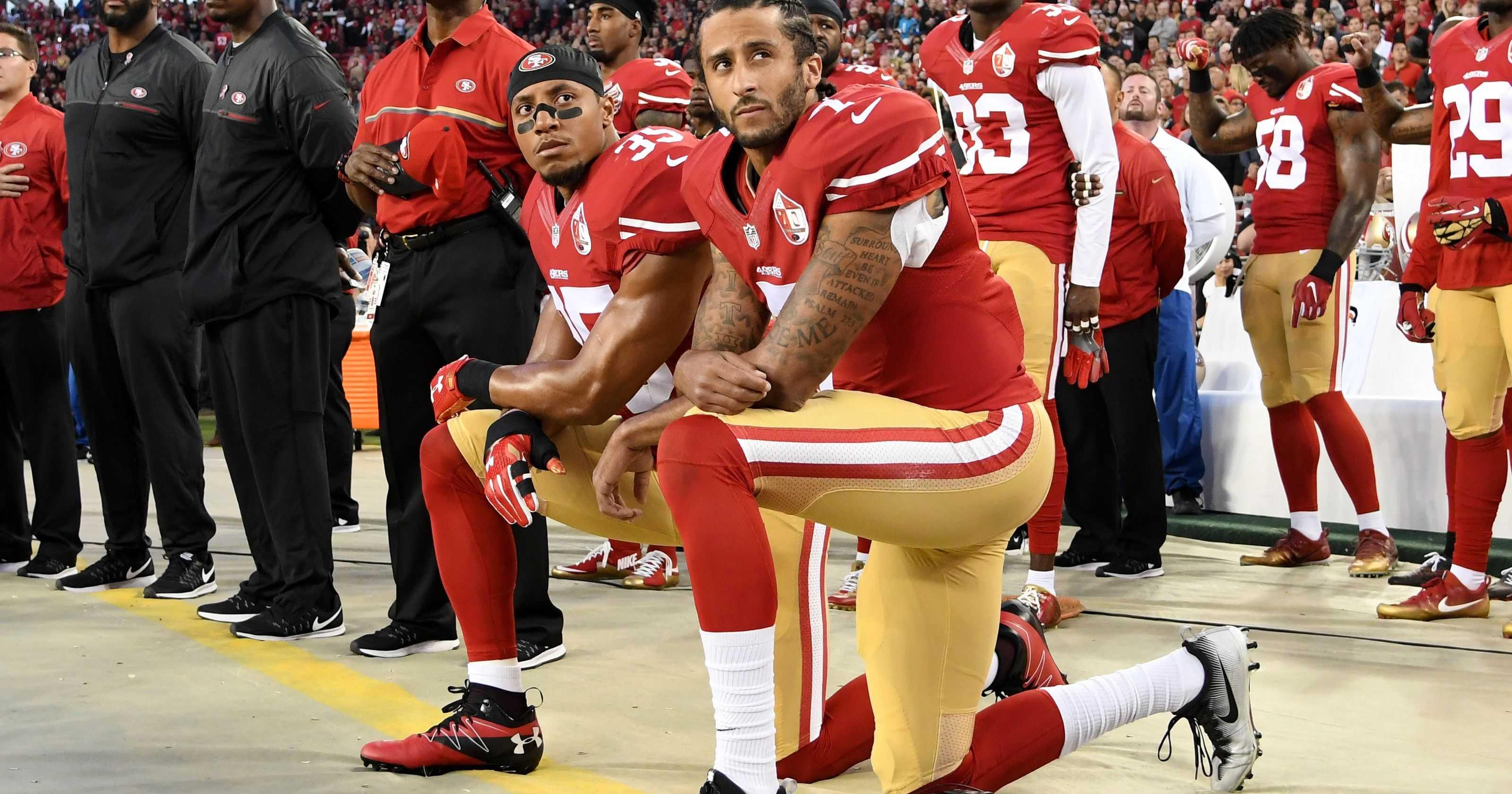 Colin Kaepernick kneeling alongside Eric Reid during the National Anthem.