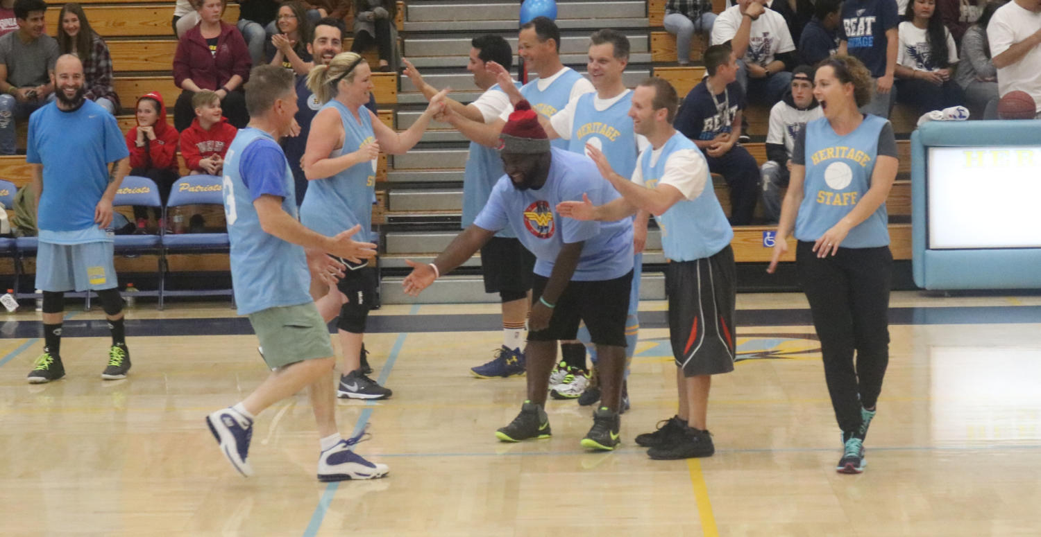 The Heritage Staff hypes each other up to prepare for the intense game.
