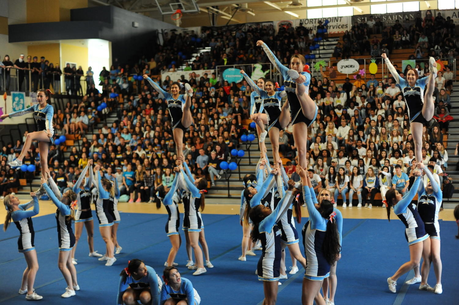 The+varsity+cheer+team+gets+the+crowd+pumped+for+the+annual+Battle+of+the+Classes+Rally.