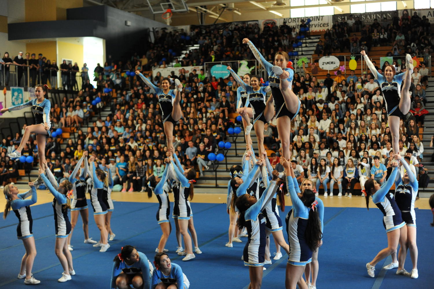 The varsity cheer team gets the crowd pumped for the annual Battle of the Classes Rally.